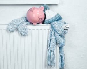 pink piggybank and scarf on a warm radiator