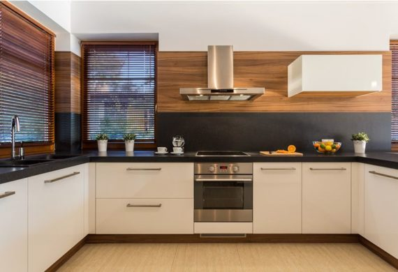 modern clean kitchen with white cupboards and wooden trim
